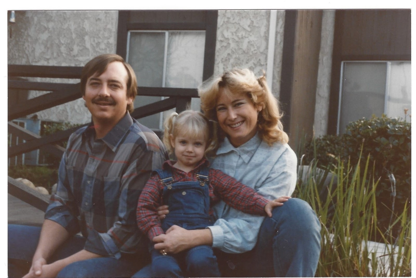 Heidi, as a young girl, with her parents.