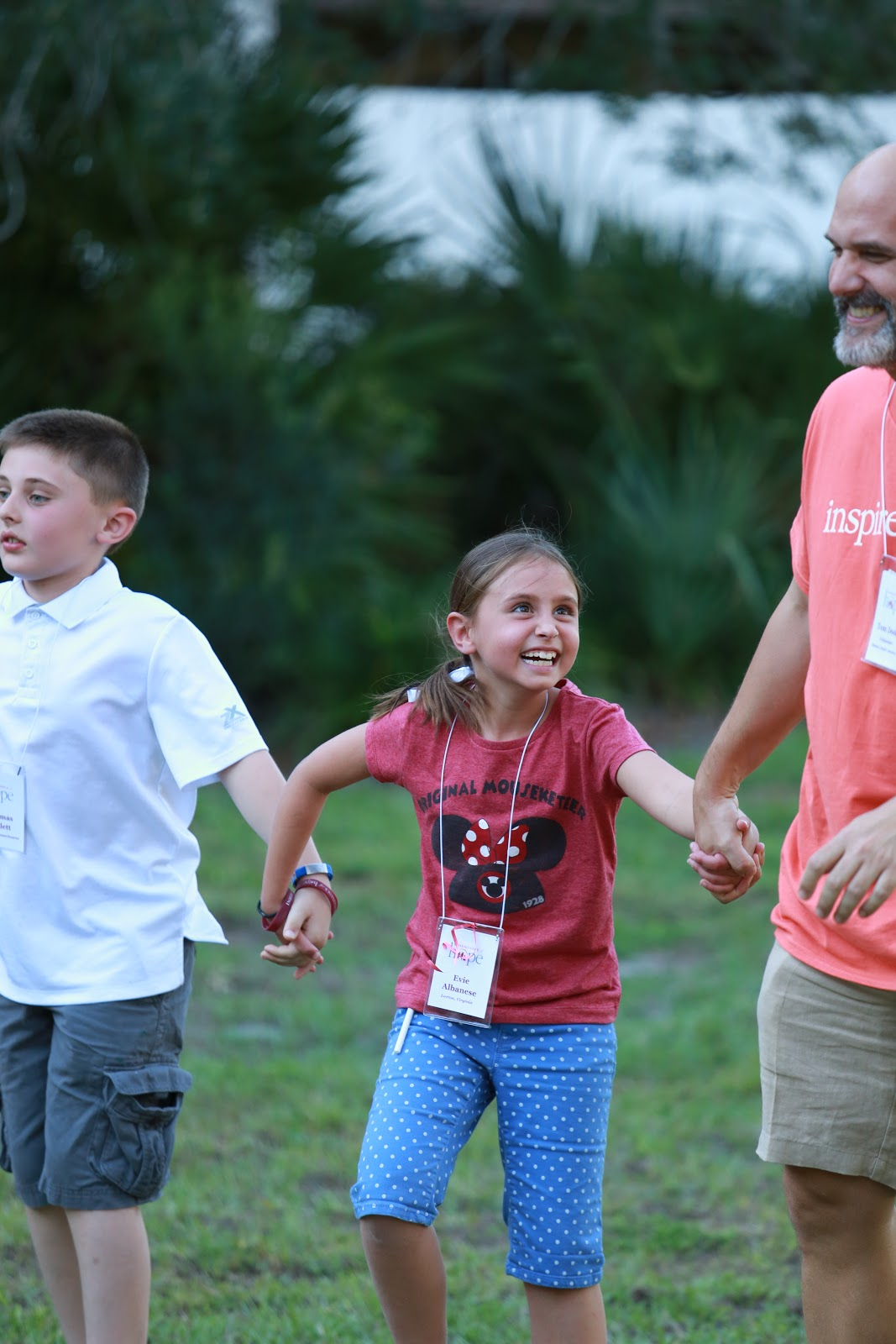 Tom creating a precious memory for another child at a retreat in Orlando, Florida
