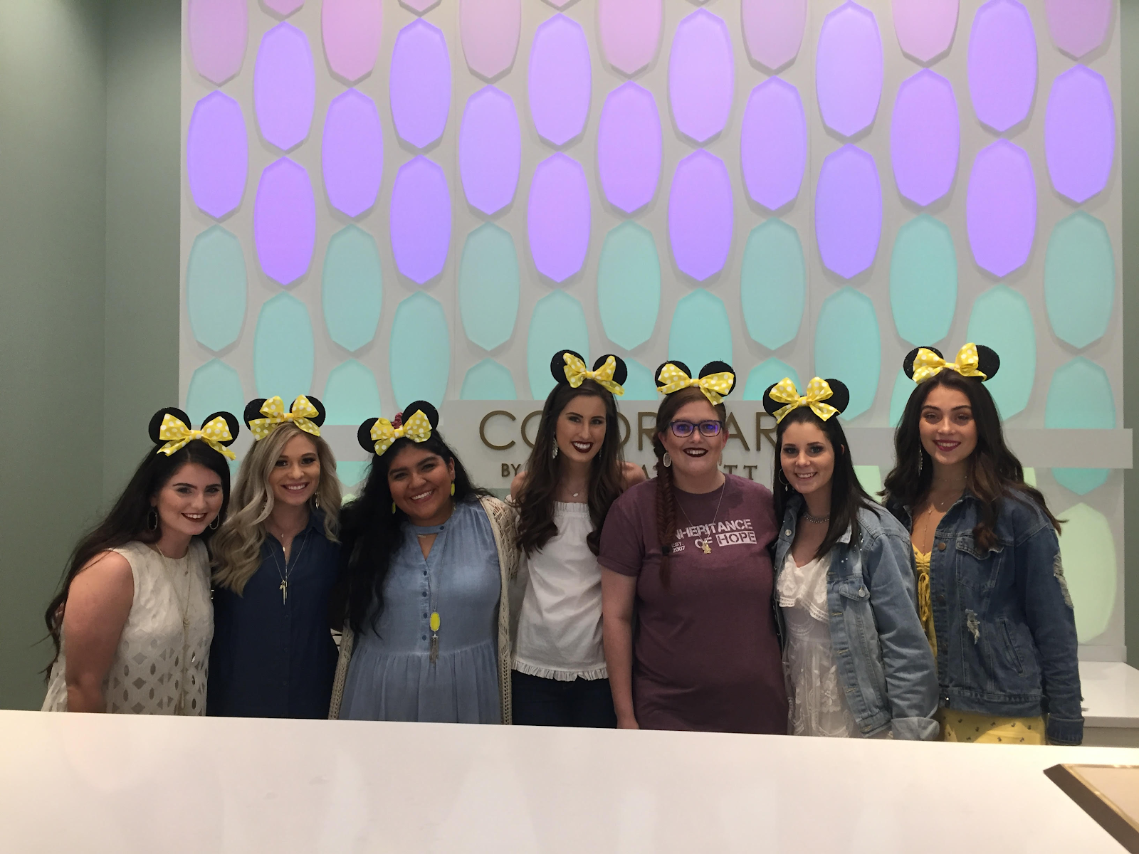 Casie (center-right in IoH shirt) celebrating Holley Day with staff at the Kendra Scott Shops at La Cantera location