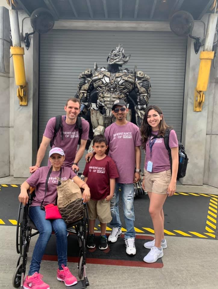 Ally (right) serving the Rivera family at Universal Studios