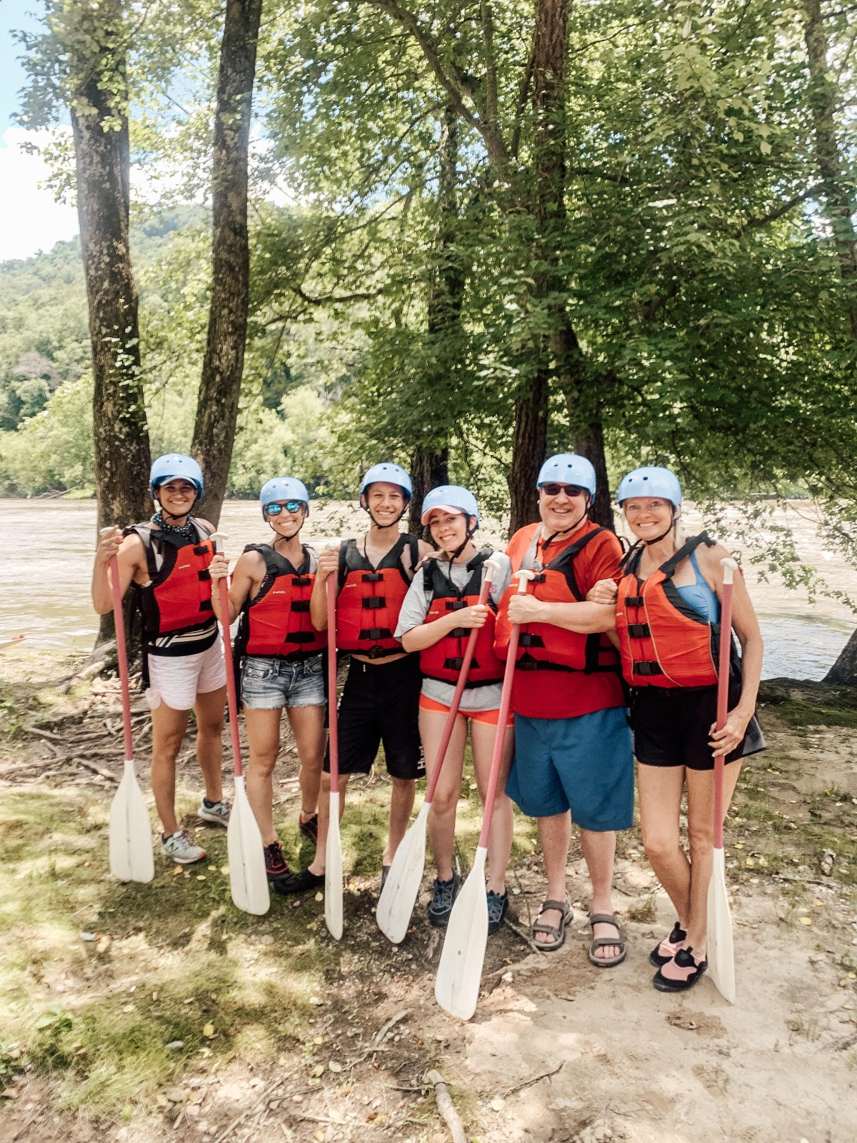 New volunteers Rae McMannis (far left) and Diane Sohl (far right) team up with IoH board member Tony Reid (second from right) to help make lasting memories with the Evans-Johnson family on the French Broad River!