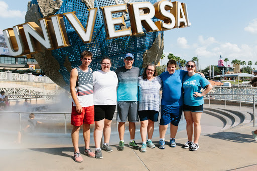 Tyler (second from right) and his family ready to take on Universal Studios
