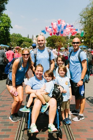 Jon (right) paying it forward to other families in California