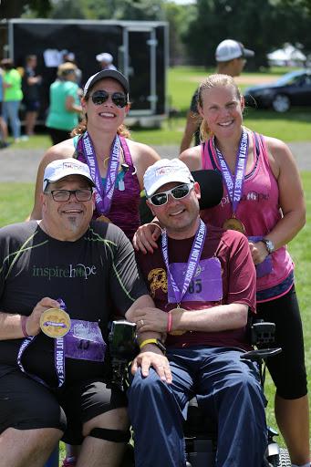 Finishers! Maria Lorzel, Heather Dodd, Blake Austin, and Chris celebrate  after the 2017 Minnesota Nut House Challenge Half Marathon