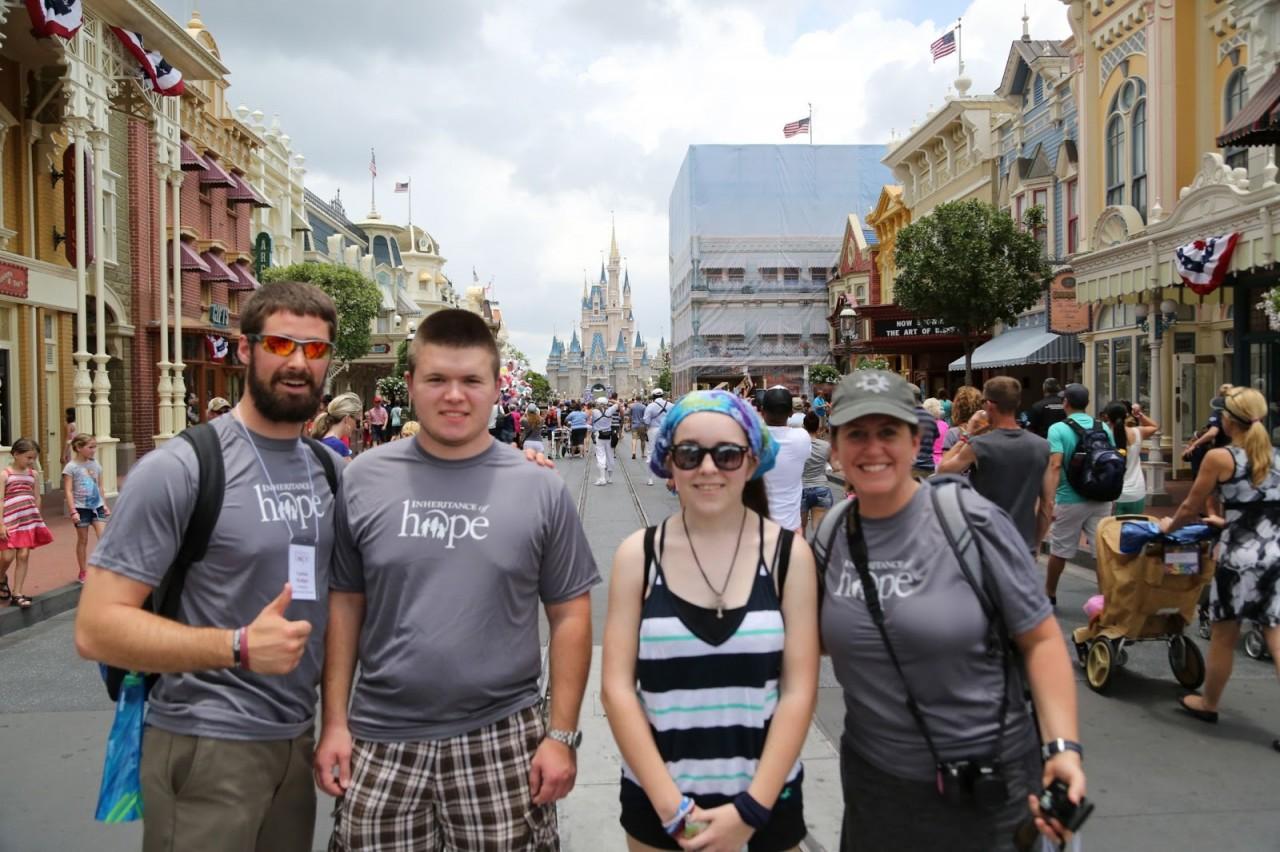 Jacob and Emily (middle) enjoying Magic Kingdom with IoH volunteers