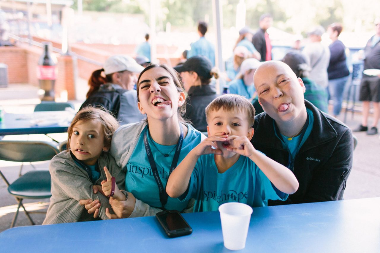Funny faces = fun times! Cutting up with the Cochran family at a baseball game.